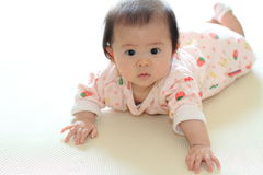 Crawling baby girl Stock Photos