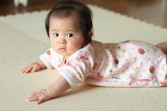 Crawling baby girl. (Japanese baby Stock Image