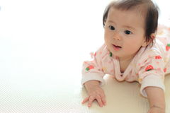 Crawling baby girl Royalty Free Stock Photography