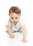 Crawling baby girl. Pretty crawling baby girl on white studio background Stock Photos