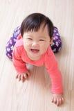 Crawling baby girl smile Royalty Free Stock Image