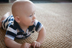 Crawling Baby on Woven Rug Royalty Free Stock Image