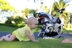 Crawling beautiful baby girl Royalty Free Stock Photos