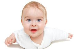Crawling blue-eyed baby Royalty Free Stock Image