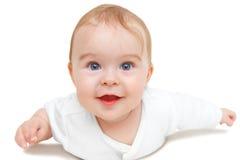 Crawling blue-eyed baby. On white background royalty free stock image