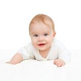 Crawling blue-eyed baby. On white background stock photography