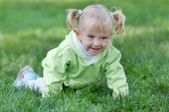 Crawling cheerful toddler Stock Photos