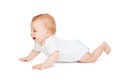 Crawling curious baby looking up Royalty Free Stock Photos