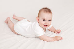 Crawling is fun. Adorable little baby crawling, on white background royalty free stock photos