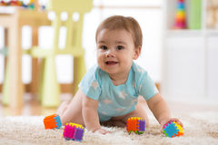 Crawling funny baby boy indoors at home Royalty Free Stock Photos