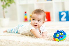 Crawling funny baby on floor at home Royalty Free Stock Photo