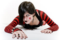 Crawling Goth Girl. Goth girl with a fierce look, crawling towards you stock photos