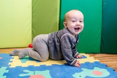 Crawling happy baby. Baby play and crawling, cute boy baby royalty free stock image
