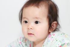 Crawling Japanese baby girl Royalty Free Stock Image