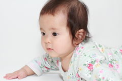 Crawling Japanese baby girl Royalty Free Stock Photography