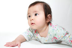 Crawling Japanese baby girl Royalty Free Stock Images
