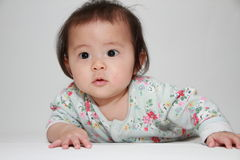 Crawling Japanese baby girl Stock Photo