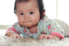 Crawling Japanese baby girl Royalty Free Stock Photos