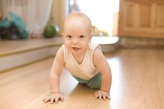 Crawling little baby Stock Photo