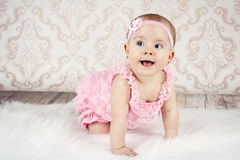 Crawling little baby girl Stock Images