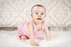 Crawling little baby girl Royalty Free Stock Images