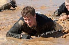 Crawling on a mud puddle royalty free stock image