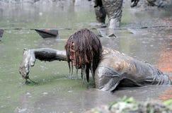 Crawling through mud Royalty Free Stock Image