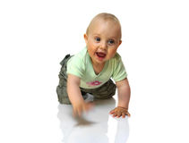 Crawling and smiling baby boy isolated Royalty Free Stock Photo