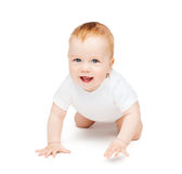 Crawling smiling baby looking up Stock Photo