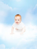 Crawling smiling baby looking up. Child and toddler concept - crawling smiling baby Royalty Free Stock Images