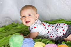 Crawling and smiling infant Stock Image