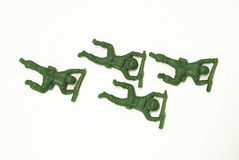 Crawling Toy Soldiers. Four Crawling Toy Soldiers on a white background royalty free stock photos