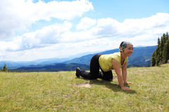 Crawling woman. Crawling smiling woman in mountains Royalty Free Stock Photos