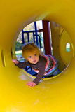 Crawling Through A Yellow Tunnel Royalty Free Stock Photography
