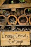 crawly kusligt övre för tät stuga Fotografering för Bildbyråer