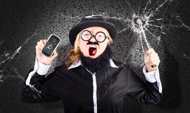 Business man with cracked mobile phone screen Stock Photo