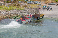 Crayfish boat being pulled onto trailer at Kleinmond harbor Stock Photo