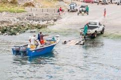 Crayfish boat being pulled onto trailer at Kleinmond harbor Stock Photo