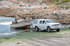 Crayfish boat being pulled onto trailer at Kleinmond harbor Stock Images