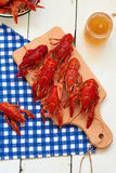 Crayfish. Boiled crayfish on a cutting board and beer Stock Images
