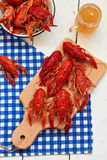 Crayfish. Boiled crayfish on a cutting board and beer Royalty Free Stock Photos