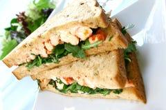 Crayfish/king prawn sandwich. Delicious crayfish/king prawn sandwich on malted bread and mayonnaise on fresh rocket Stock Photo