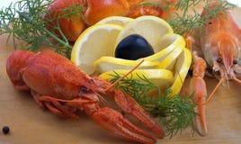 Crayfish and lemon isolated. Crayfish and lemon isolated on white Stock Photos
