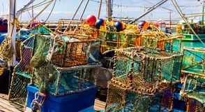 Crayfish nets and traps on a small fishing boat royalty free stock photography