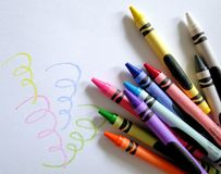 Crayon Art. Colorful wax crayons and swirls Stock Photo
