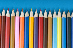 Crayon on blue background Stock Images