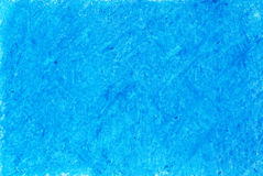 Crayon on blue background Royalty Free Stock Image