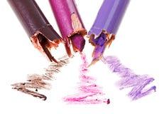 Crayon cassé d'ombre d'oeil avec des échantillons de rappe Images stock