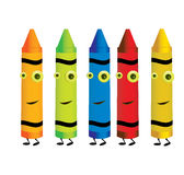 Crayon characters 1. Smiling crayons in five colors isolated on a white background Royalty Free Stock Photos