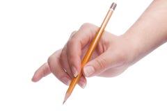 Crayon chez la main de la femme d'isolement sur le blanc Photo stock